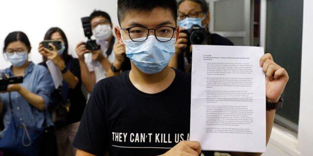 Hong Kong pro-democracy activist Joshua Wong shows his disqualification notice during a press conference in Hong Kong, July 31. (AP Photo/Kin Cheung)