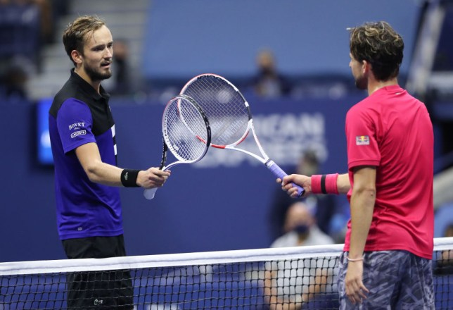 Daniil Medvedev of Russia and Dominic Thiem of Austria tap rackets at centercourt after Thiem won their Men's Singles semifinal match on Day Twelve of the 2020 US Open at the USTA Billie Jean King National Tennis Center on September 11, 2020 in the Queens borough of New York City.