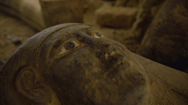 A handout picture released by the Egyptian Ministry of Antiquities shows one of thirteen 2500 year-old wooden coffins (Photo by -/Egyptian Ministry of Antiquities/AFP via Getty Images)