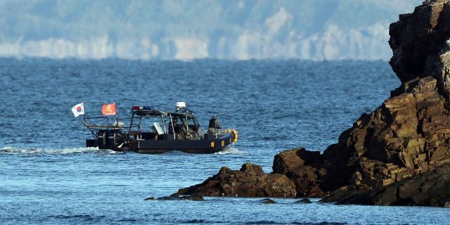 A South Korean marine boat patrols near Yeonpyeong island, South Korea, on Sunday. (Baek Seung-ryul/Yonhap via AP)