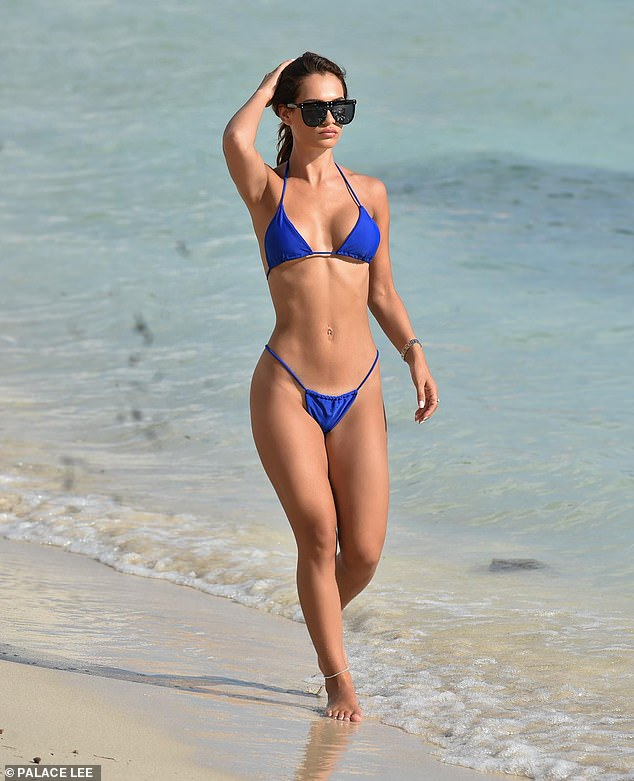 Sizzling: TOWIE's Nicole Bass, 28, proudly displayed her figure in a skimpy electric blue bikini as she hit the beach during a sunny getaway to Crete earlier this month