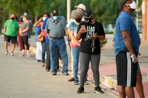 Voters stand in line before the polling center is opened at Disciple Central community church in DeSoto, Texas in July.