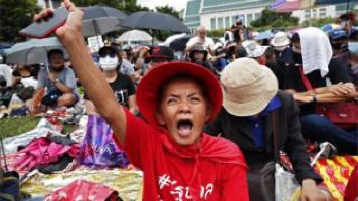 Pro-democracy protesters gesture during a protest at Thammasat University in Bangkok, 19 September