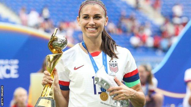 Alex Morgan celebrates with the Women's World Cup