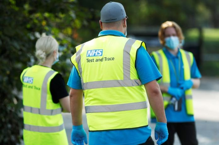 © Reuters. FILE PHOTO: NHS Test and Trace workers are seen at a test station in Richmond-Upon-Thames