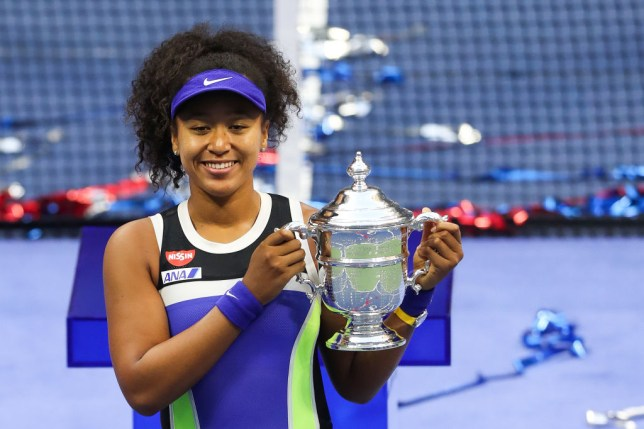 Naomi Osaka of Japan celebrates with the trophy after winning her Women's Singles final match against Victoria Azarenka of Belarus on Day Thirteen of the 2020 US Open at the USTA Billie Jean King National Tennis Center on September 12, 2020 in the Queens borough of New York City.