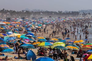 People flock to the beach in Santa Monica, California, during a heatwave