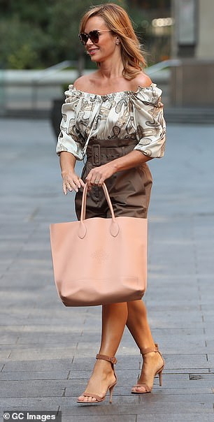 Toned: She showed off her incredibly gym-honed legs in the shorts which featured a statement belt
