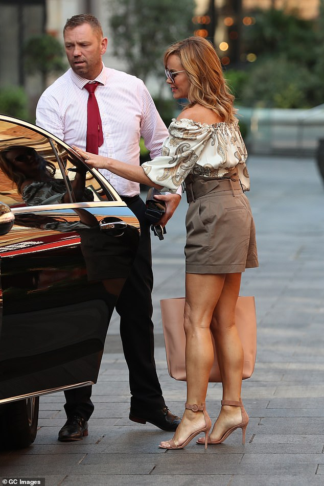 Glam: Amanda hopped into a car after leaving the studios this morning after presenting her show