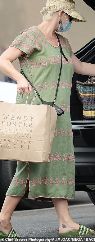 Fall vibes: With fall just around the corner, Katy appeared to stock up on various knit items