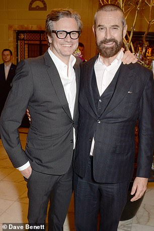 Rupert Everett is pictured above at the movie premiere with Colin Firth