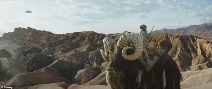 Luke's home at last? A Tusken Raider is seen on a desert planet that resembles Tatooine