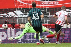 Meslier saves Lundstram's shot.