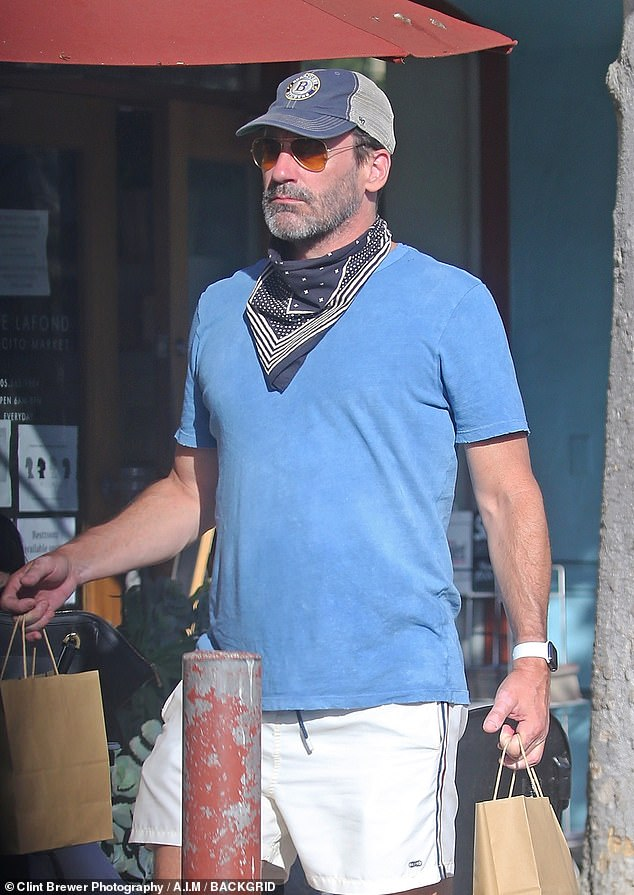 Handsome: The good looking star carried two bags out of the store before heading to the beach