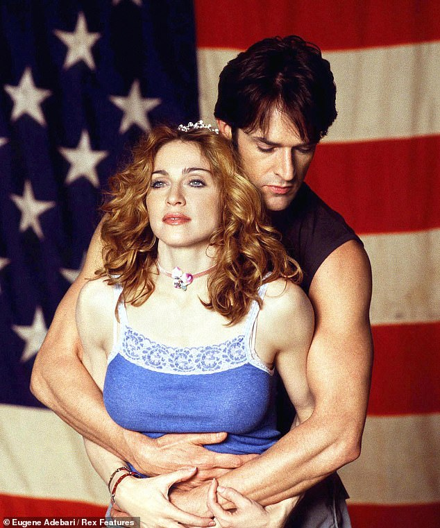 Rupert Everett is pictured above with Madonna.Film festivals can be hellish affairs. The powerful flex while the powerless grovel, and the rest of us juggle our way up or down