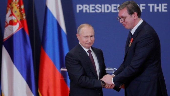 Russian President Vladimir Putin decorates Serbian President Aleksandar Vucic with an order of Alexander Nevsky after their meeting in Belgrade in January