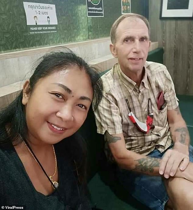 Terrence Cockrill, 62, (pictured with his 43-year girlfriend Nanthakan Kaewsiri) was discovered next to the black strap from a woman's handbag in Nakhon Ratchasima, northern Thailand