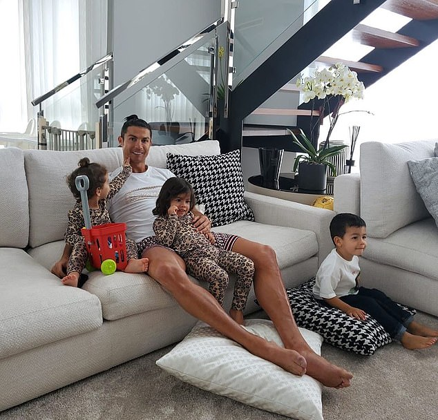 Police are reportedly investigating a burglary at Cristiano Ronaldo's home in Madeira, that was reported to them on Wednesday morning by a relative. Pictured: Ronaldo with his children at his 7-storey home in April. The thief reportedly got in through a garage door that was left open