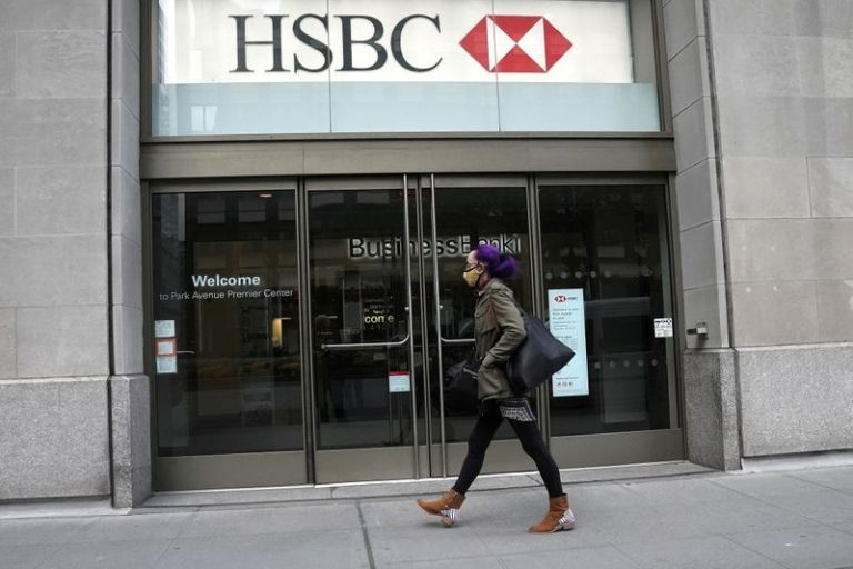 HSBC to accelerate restructuring plan as third quarter profit tumbles 35%