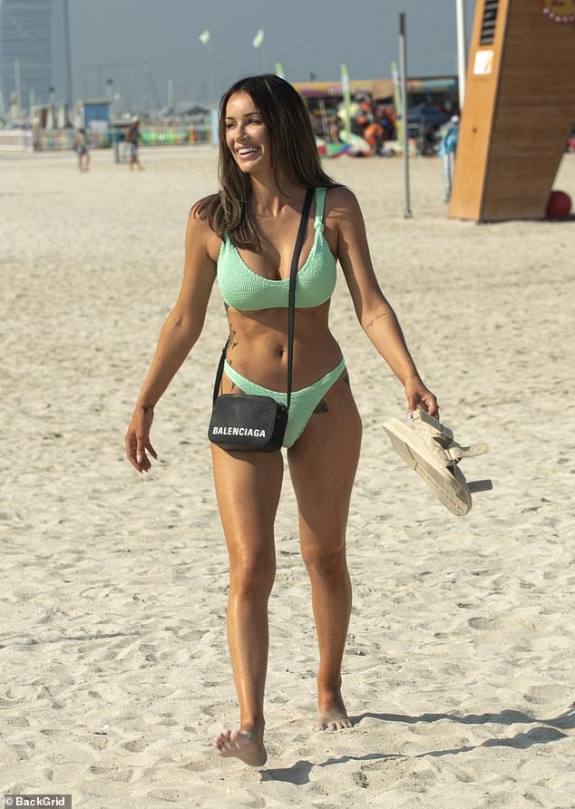 Wow: Laura Anderson, 31, looked radiant as ever as she soaked up the sun during a day at the beach in Dubai on Saturday