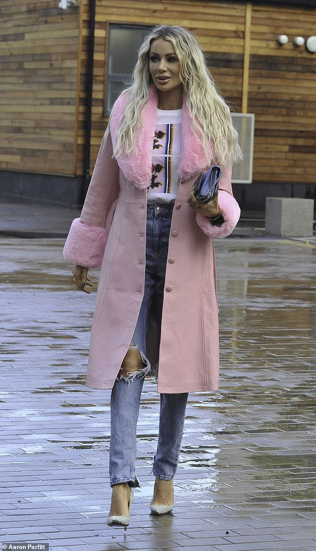 Olivia Attwood looks chic in a pink coat as she steps out with fiancé Bradley Dack in Manchester