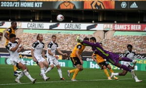 Fulham goalkeeper Alphonse Areola, who put in an excellent performance for the losing side, punches away as Wolves attack in the penalty area at Molineux.