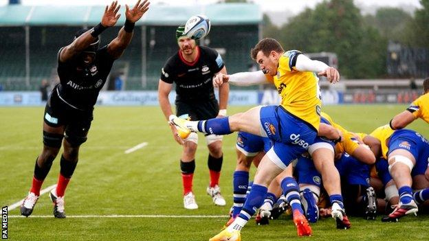 Ben Spencer launches a clearing kick for Bath against Saracens