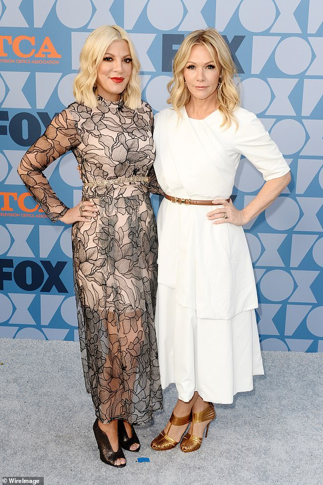 Dynamic duo: Tori Spelling and Jennie Garth were not pleased to hear of Jessica Alba's negative experiences on set of Beverly Hills 90210 as they talked about it on a teaser forpodcast 9021OMG, as the two are seen in August 2019