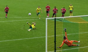 Teemu Pukki sends his penalty high and wide afte slipping.