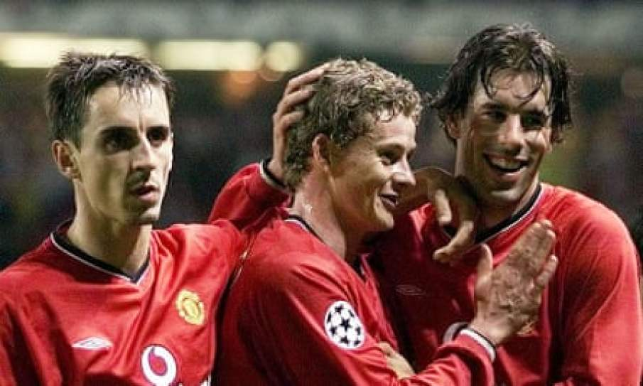 Ole Gunnar Solskjær celebrates with Gary Neville and Ruud van Nistelrooy after a 3-0 win against Olympiakos in 2001