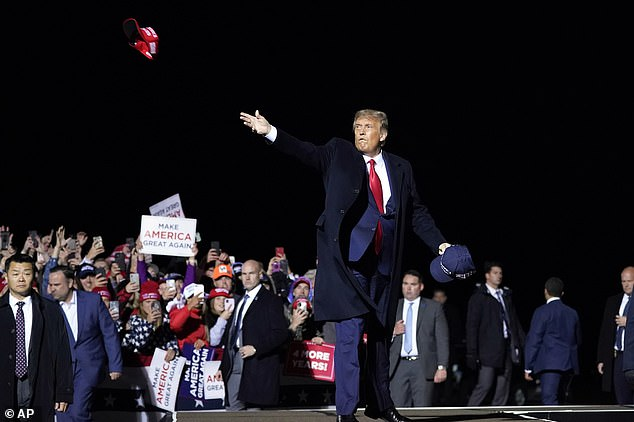 WEDNESDAY:President Trump throws hats to supporters after speaking at a campaign rally at Duluth International Airport in Minnesota
