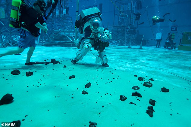 Preparing for the Moon involves learning to move in the bulky spacesuits - the best way to do that is taking them underwater in a large pool with a simulated lunar environment
