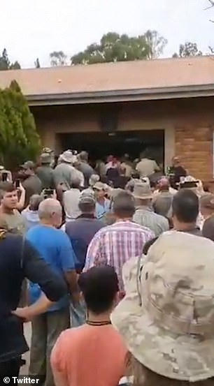 Demonstrators are seen flooding through the main entrance of the court on Tuesday during chaotic scenes where the guards struggled to maintain order