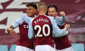 Aston Villa's English striker Ollie Watkins (L) celebrates after scoring.