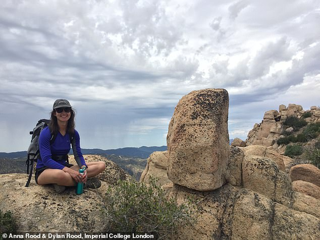 Anna Rood sat next to a precariously balanced rock that will be used to validate how earthquakes rupture along the San Andreas fault