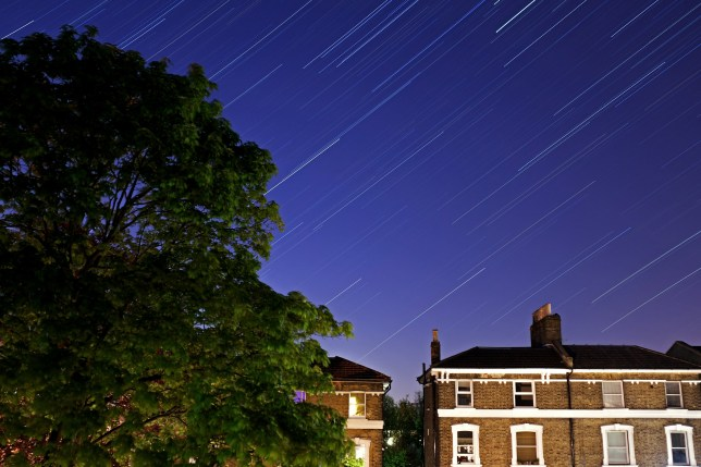 Forest Hill is illuminated under the stars on a clear night on April 21, 2020 in London, England. The clear skies created by the New Moon coincide with the Lyrid meteor shower, an annual display caused by the Earth passing through a cloud of debris from a comet called C/186 Thatcher. (Photo by Simon Robling/Getty Images)