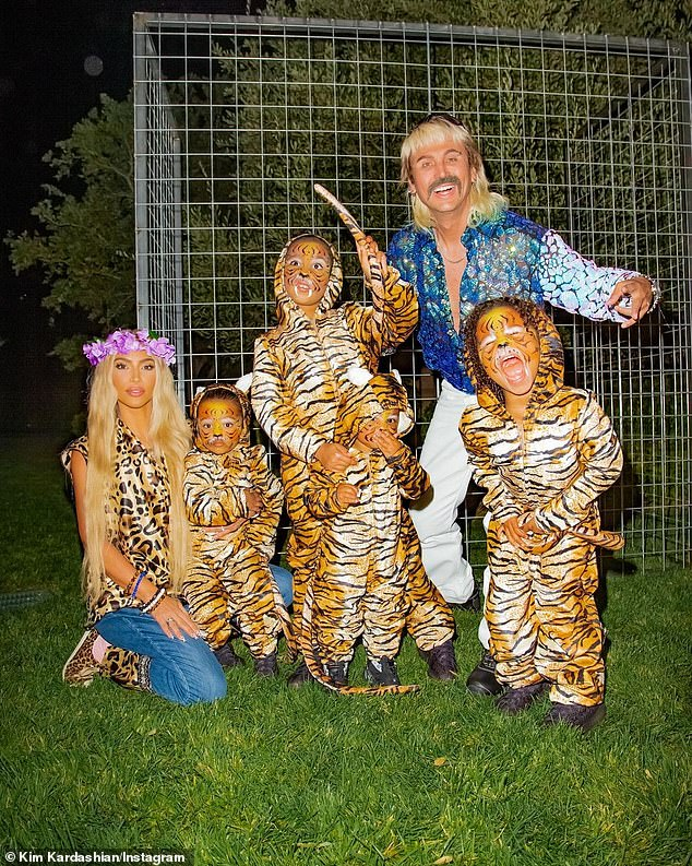 Family fun:Kim Kardashian dressed as Carole Baskin from Tiger King. And her pal Jonathan Cheban was Joe Exotic: 'I don't think anything will beat Sonny and Cher BUT this comes Close!! Joe Exotic, Carol Baskin and MY tigers'