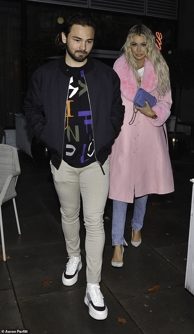 Looking good: The Love Island star, 29, turned heads in a stylish baby pink coat as the couple continued to film scenes for their reality show Olivia Meets Her Match