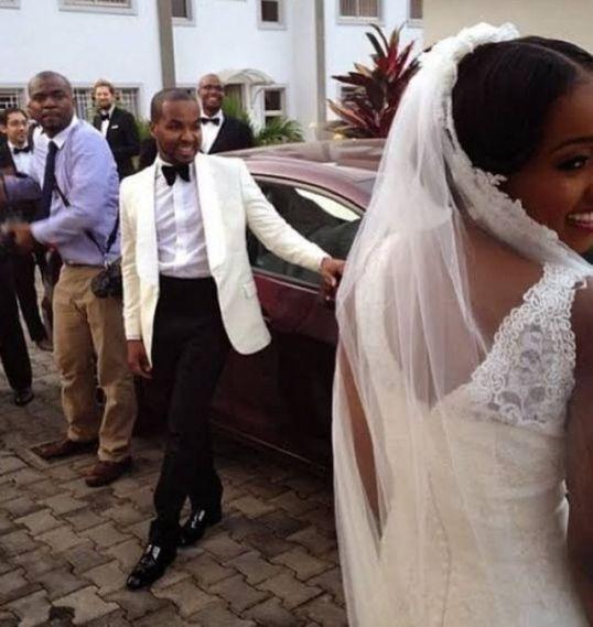 Rukky indimi with her groom Usman Dantata as she wear her wedding dress