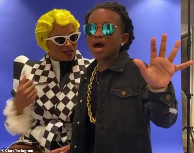 Having fun:Ciara also wore a Cardi B costume for this year and dressed her six-year-old son Future as Cardi's husband Offset of Migos fame