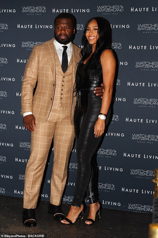 Dapper:At the Haute Living Celebration of 50 Cent With Watches Of Switzerland event, 50 Cent was clad in a beige plaid three piece-suit with a black tie