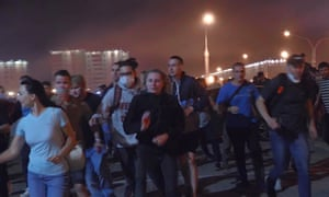 Protesters in Minsk, running away from teargas.