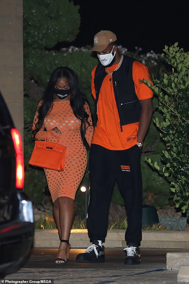 Lovers in LA: The 23-year-old was ready for a night out on the town with her main man as she stepped out for a romantic sushi dinner with Karl-Anthony Towns on Tuesday night