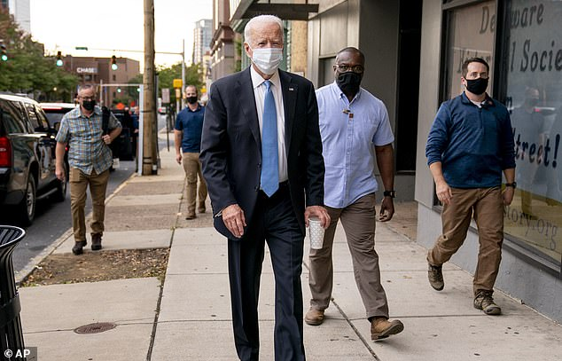 Joe Biden, pictured on the campaign trail in his home state of Delaware on Thursday, spent Tuesday night in fairly close proximity to the president but there was no immediate word on whether he had been tested or was isolating
