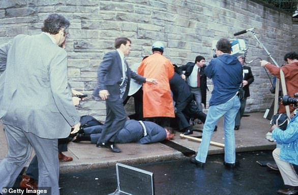 Chaos surrounds shooting victims immediately after the assassination attempt on President Reagan, March 30, 1981, by John Hinkley Jr outside the Hilton Hotel in DC