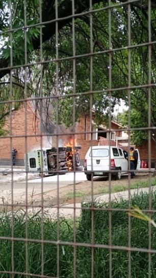 Police van burning outside court