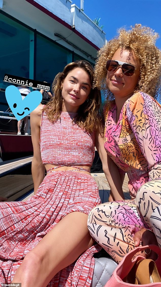 All aboard! Bambi had spent the day cruising the open waters with her gal pal, Sneaky Sound System singer Connie Mitchell (right)