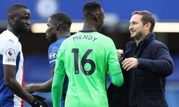 Chelsea goalkeeper Edouard Mendy and Frank Lampard, the head coach.