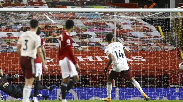 Pierre-Emerick Aubameyang (right) scores for Arsenal