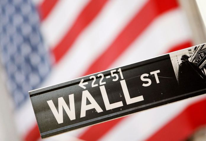© Reuters. FILE PHOTO: Wall Street sign is be seen outside the New York Stock Exchange